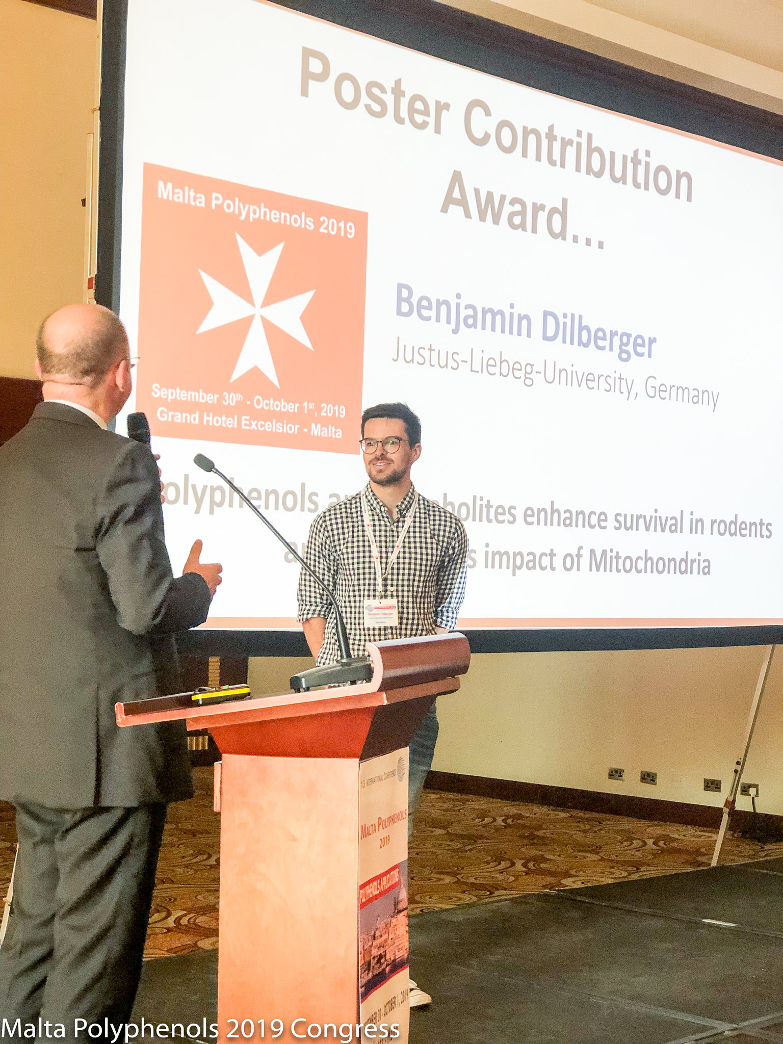 The Poster Contribution Award was discerned to Dr. Benjamin Dilberger